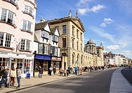 View of Oxford High Street, including the facade of the Queen´s College, Oxford University, England, UK.