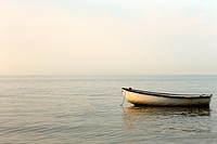 Rowboat laying in the North Sea off the coast of Amrum, North Frisian islands, Schleswig-Holstein, Germany, Europe.