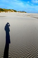 Shadow of a photograhper on the sand, Amrum, North Frisian islands, Schleswig-Holstein, Germany, Europe.
