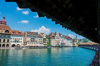 River Reuss with Chapel bridge and cityscape with blue sky and clouds in Lucerne, Switzerland.