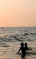 Children playing on the beach in Sihanoukville