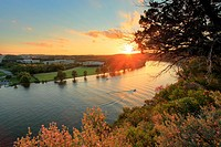 Sunset on Lake Austin - Austin, TX. As the sun sets, a boat glides down a picturesque section of the Colorado River in northwest Austin, called Lake A...