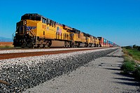 Picacho, AZ, USA - October 24, 2014: Approaching freight train loaded with cargo.