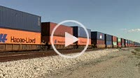 Picacho, AZ, USA - October 18,2014: Freight train containers moving along the track.