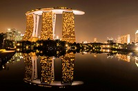 Marina Bay Sands Hotel reflecting in the water, Singapore, Asia.