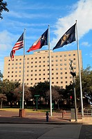 Flags at Tranquility Park - Houston, TX. From left to right US Flag, Texas state flag and the City of Houston Flag in downtown Houston.