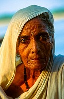 portrait of old woman at the ghats of varanasi, india