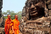 Buddhist monks at Bayon temple, Angkor thom, UNESCO World Heritage Site, Siem Reap, cambodia