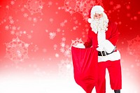 Composite image of smiling santa claus opening sack