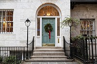 Christmas Wreath Decorating the Door of an Upper East Side, New York City, Townhouse.