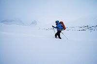 Female nordic ski tourer in deep snow near Kebnekaise Fjällstation, Lapland, Sweden.