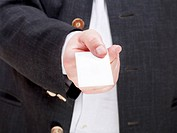 front view of blank business card in male hand