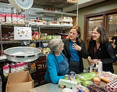 New York City Council Speaker Melissa Mark-Viverto, center, with Councilmember Helen Rosenthal, right, greets a volunteer at the West Side Campaign Ag...