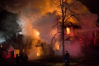 Detroit, Michigan - Firefighters battle a fire which destroyed a vacant home in Detroit´s Morningside neighborhood. The city has tens of thousands of ...