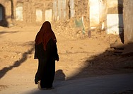 Woman Passing By Demolished Houses, Old Town Of Kashgar, Xinjiang Uyghur Autonomous Region, China
