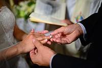 Couple exchange rings during wedding ceremony.
