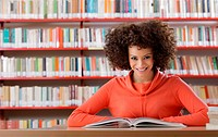Portrait of female student in library