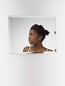 Teenage Girl in a Mirror