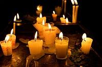 Candles inside La Merced church, Antigua, Guatemala, Central America.