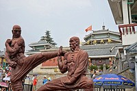 Statues of monks at the entrance of a building, Shaolin Monastery, Henan Province, China.