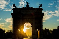Arco della Pace and Castle Sforza in sunrise and blue sky with clouds in Milan, Italy.