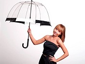 Young fashionable woman smile and holding umbrella