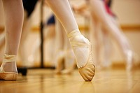 pointed toe in ballet slippers at a ballet school in the uk.