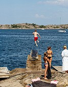 Kid jumps to the sea, Fjallbacka, bohuslan region, west coast, Sweden.