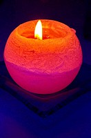 Orange candle on blue background