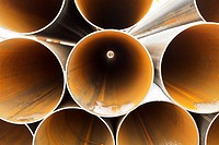 tops of rusty pipes close up
