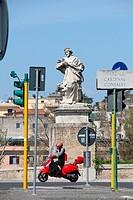 Priest holding cross statue by ponte milvio bridge in Rome Italy
