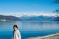 Portrait of little girl outdoors along the shore of Lake Maggiore, Ispra, Varese, Lombardy, Italy