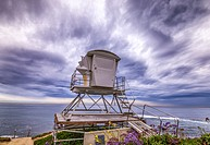 Majestic storm clouds over the ocean with a lifeguard tower in the foreground. La Jolla, California, United States.