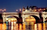 Paris, France - Seine River, With Pont Neuf Bridge & Ile de la Cité, at Night.