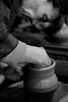 Japan, Koshinetsu Region, Niigata Prefecture, Agano, Woman making clay pots.
