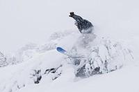 Male snowboarding near Homer, Kenai Peninsula, Alaska, winter