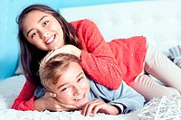 Teenage girl and boy playing