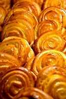 Many yellow cakes in cafe in morning