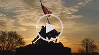 ARLINGTON, VA - APRIL 15: The Marine Corps War Memorial is silhouetted against an orange colored sky at sunrise on April 15, 2015 in Arlington, Virgin...