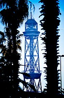 Cable car tower between palms. Barcelona, Catalonia, Spain.