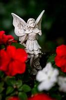 Fairy Figurine Among Flowers