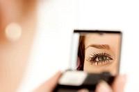 woman eye in the mirror