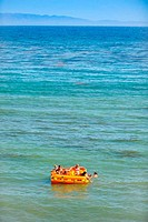 Raft full of young kids on the Ocean