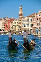 Gondolas and gondoliers, Palaces facades, church steeple, Canal Grande, Venice, Venetia, Italy.