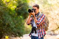 photographer taking photos in mountain