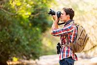 hiker taking photos in mountain
