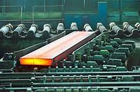 hot steel on conveyor.