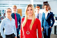 Blond young businesswoman multi ethnic teamwork group as leader in office.