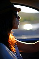 Young woman driving car in Ibiza, Balearic Islands, Spain.