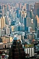 View across Bangkok skyline showing office blocks and condominiums